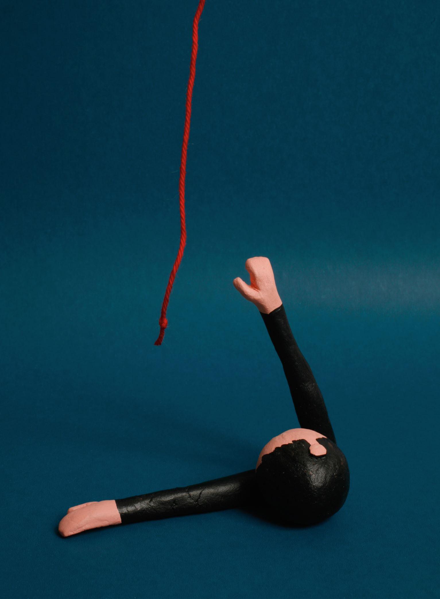 poppetje dat rode draad probeert te pakken